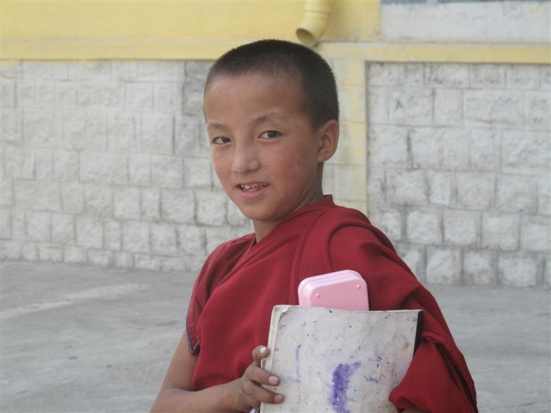Younk Monk after his class eye the camera.
