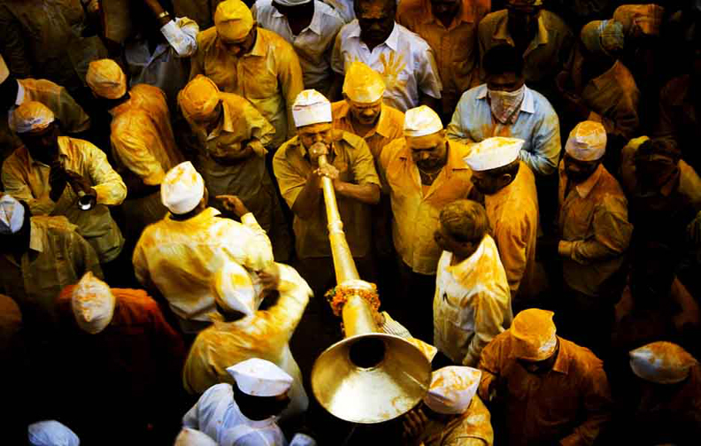 Devotee performing   prayers with  musical instrument during Yatra of Lord Khandoba  at Jejuri tample