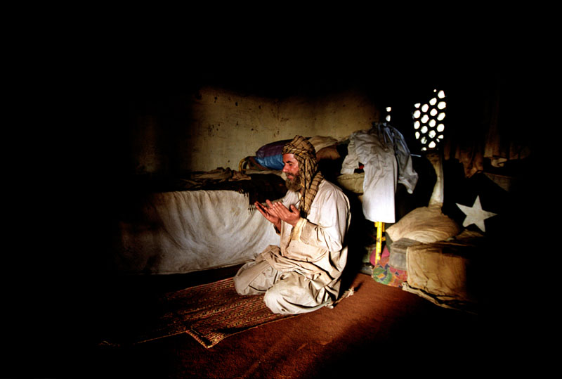 A worker prays in his quarters