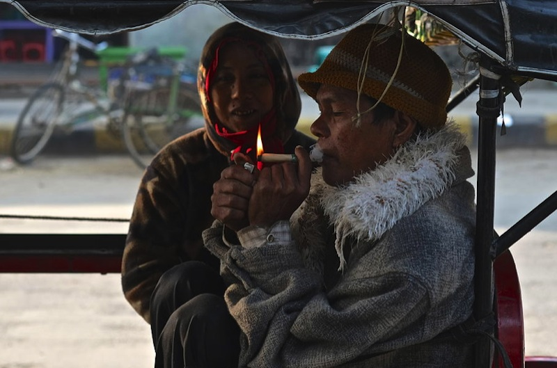 Man lights a cigarette