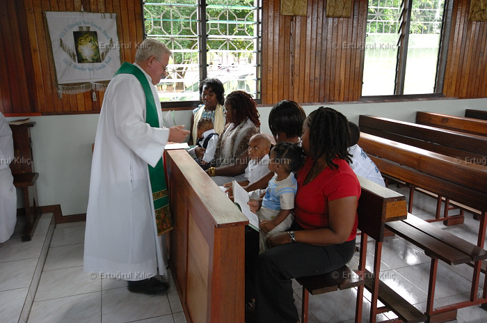 Baptise Ceremony in one village's Roman Catholic Church : Suriname