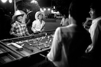 Boys playing foosball on the plaza in Ajijic