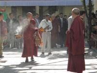 The Dalai Lama comes out of his residence in Dharamsala, India