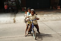 three kids on the bike