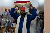 Guru Granth Sahib is taken to the bed