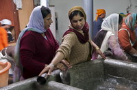 Sikh woman perform seva