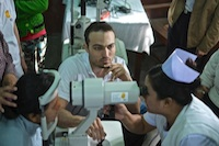 Dr Athanasiov training the ophthalmic nurse in the use of new equipment for Kalaymyo Eye Centre