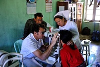 Dr James Muecke testing out new donated equipment at Hakha Eye Centre