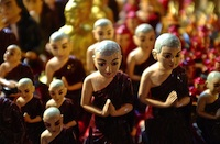 Praying monks statuettes
