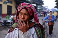 Woman smoking a cheroot , Myanmar