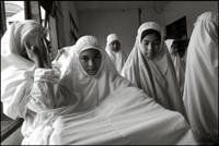 Girls getting ready for the midday prayer at an orphanage in Banda Aceh Indonesia