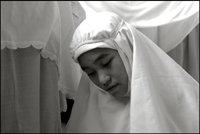 A girl during her midday prayer at an orphanage in Banda Aceh Indonesia