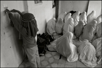 Two girls are playing, while to others are still praying at an orphanage in Banda Aceh Indonesia