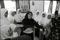 A student of the Fajar Hidayah organization plays a game with the girls at an orphanage in Banda Aceh Indonesia