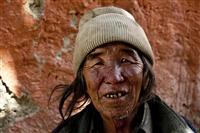 A portrait of an local Loba man in Upper Mustang