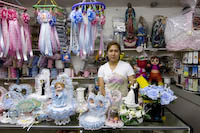 Delores Barrera behind the counter of her Dulceria de las Americas
